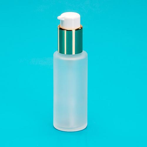50 ml Flasche Glas, rund, edelmatt, Dispenser gold/weiß, Hub 0,5 ml Kopf zum Verriegeln
