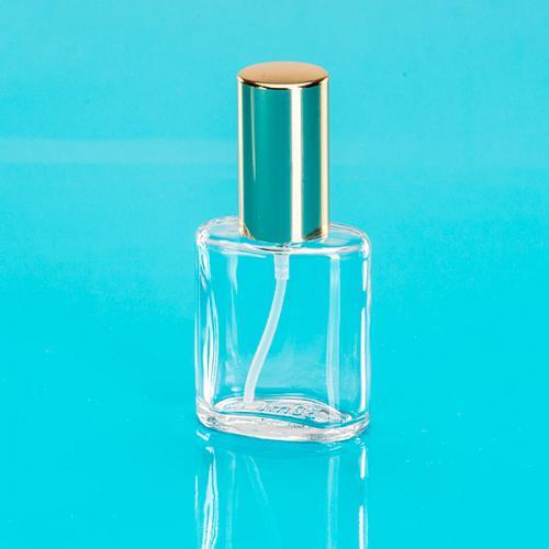 30 ml Klarglas Flasche oval, Sprühkopf u. Kappe goldf. Steigrohr ungekürzt