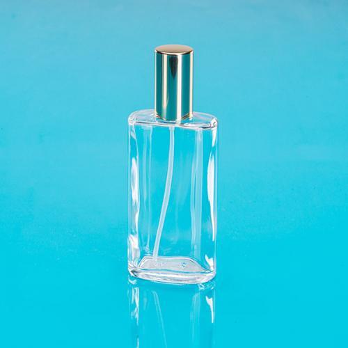 100 ml Klarglas Flasche oval, Sprühkopf u. Kappe gold, Steigrohr ungekürzt