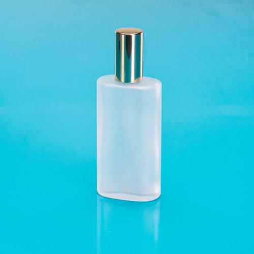 100 ml Glas-Flasche oval, matt, Sprühkopf u. Kappe gold, Hub 0,14