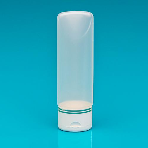 100 ml tube-bottle nature PE,  oval flip-lid white/gold PP