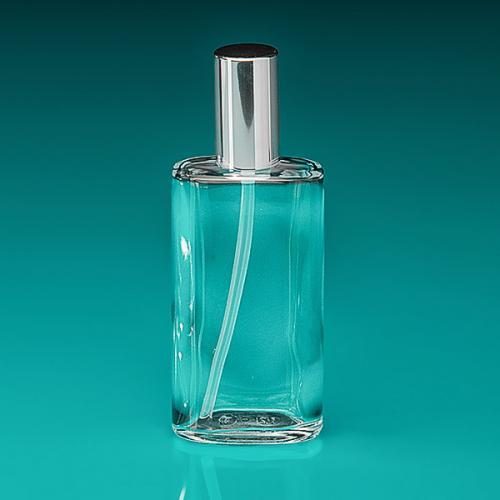 100 ml Flasche Glas, oval, Dispenser silber, Kappe silber Hub 0,15 ml, Steigrohr ungekürzt